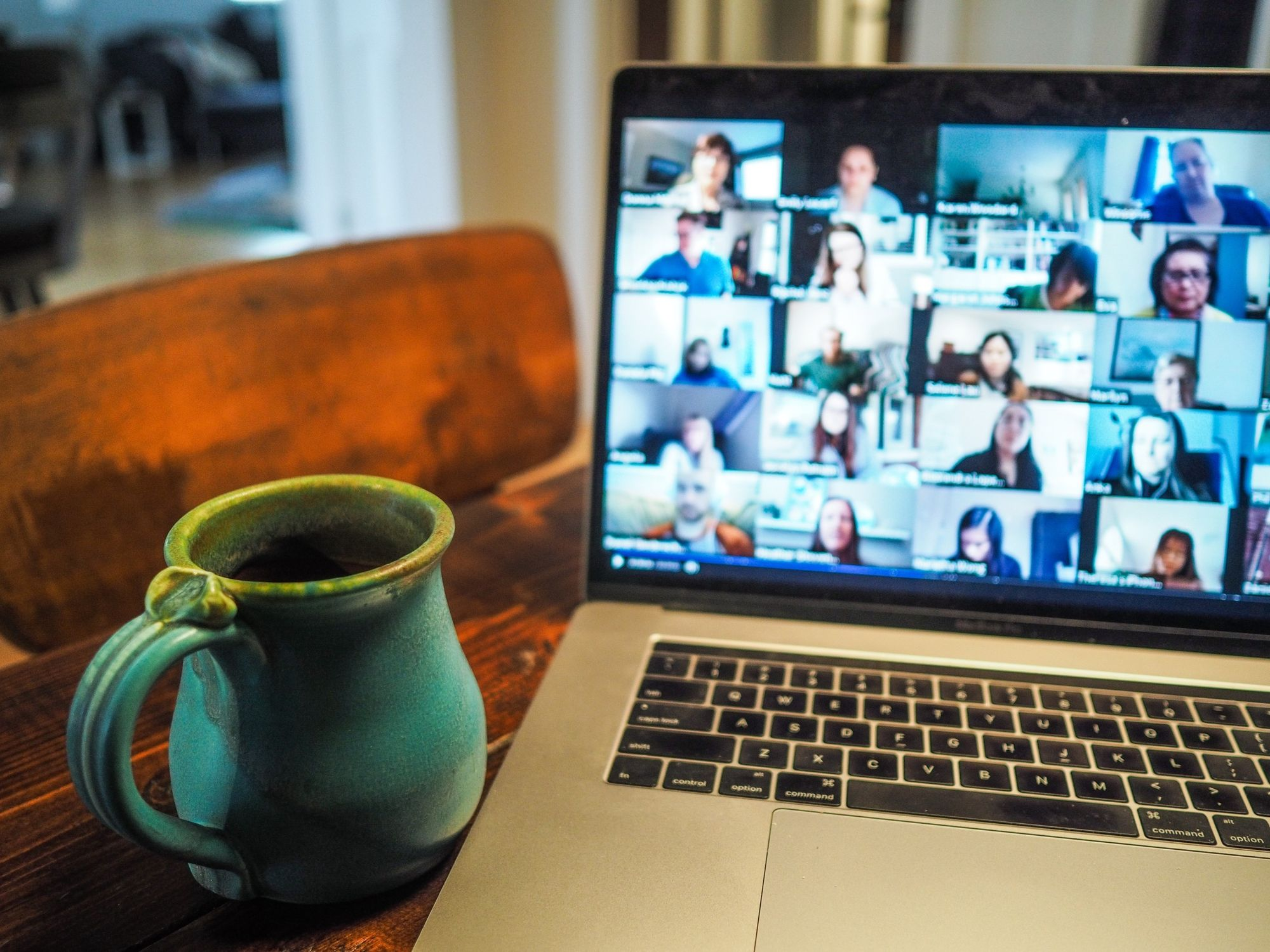 laptop with Zoom screen next to mug_team building activities for work_flok