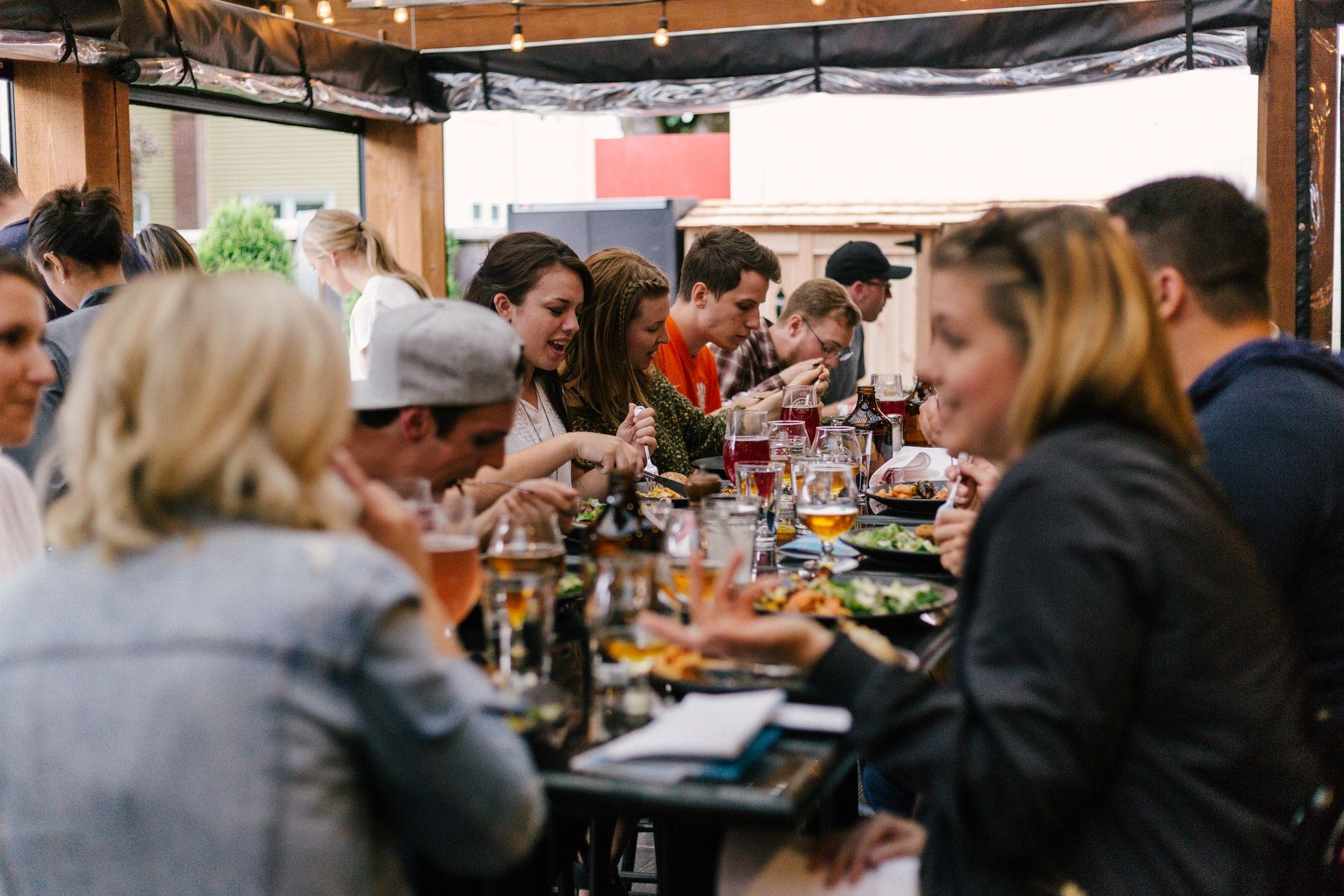 group eating at a restaurant__how to plan a corporate retreat_flok
