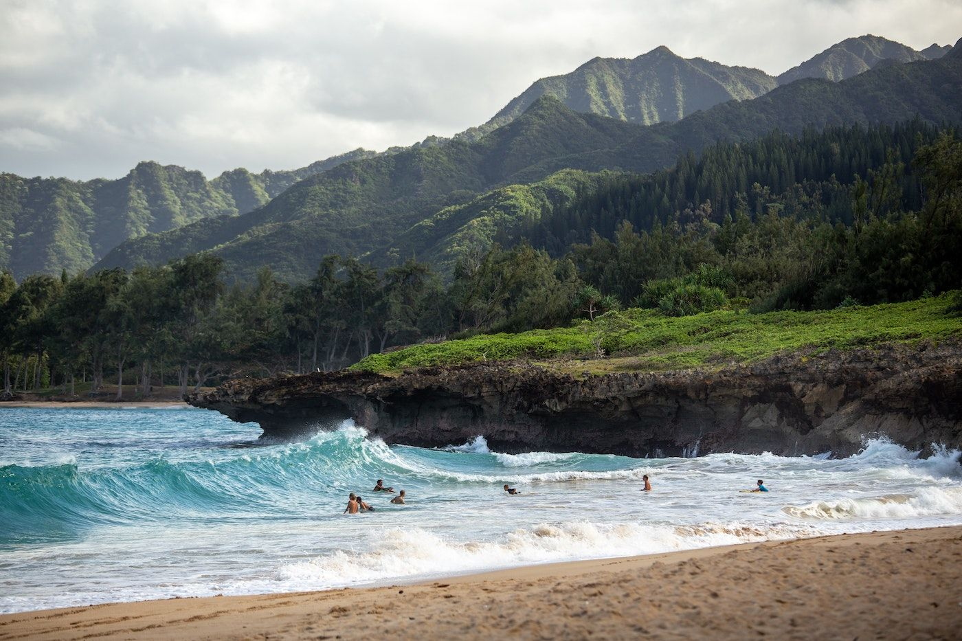big wave with green mountains in background_best corporate retreat destinations_flok