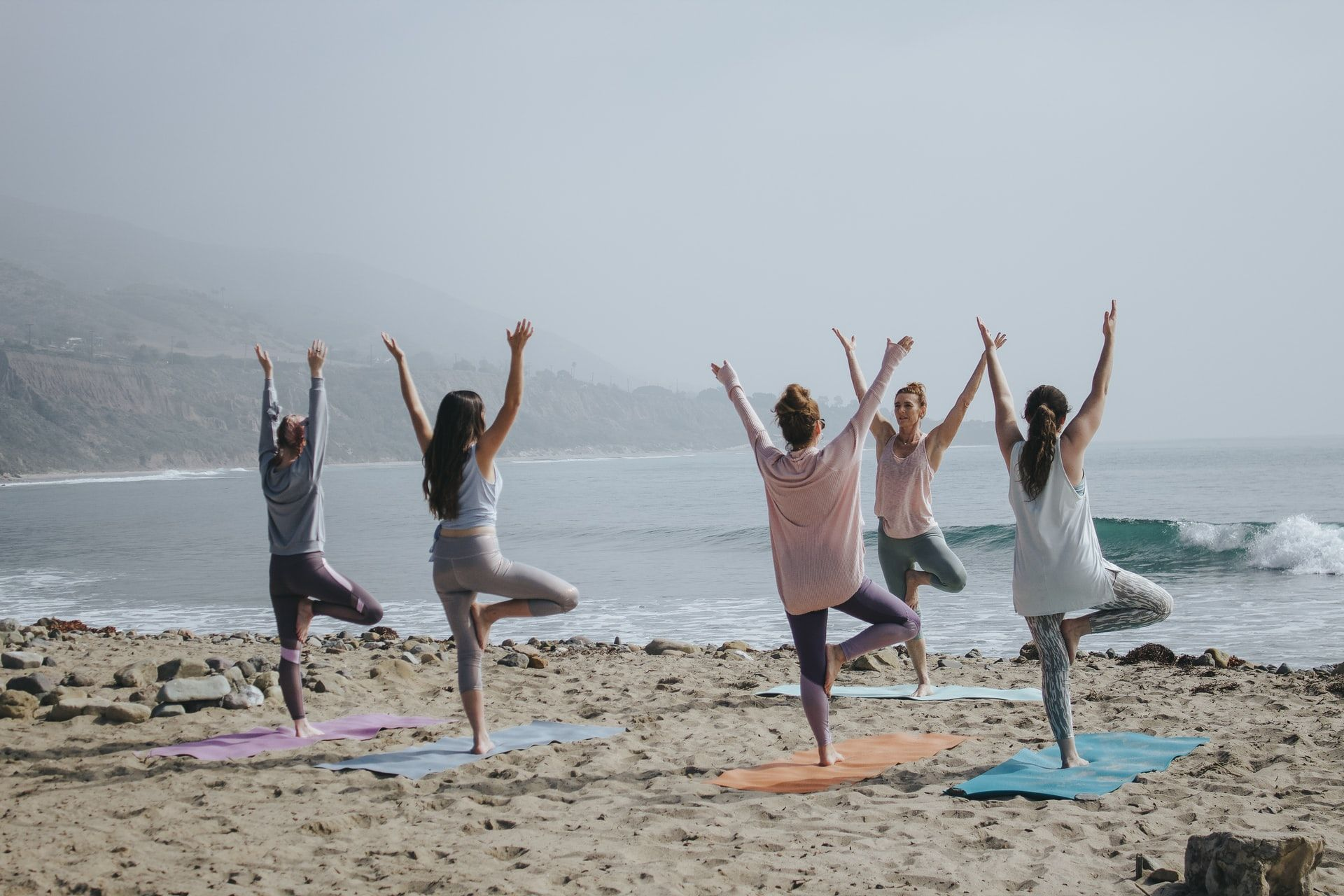 yoga on the beach__how to plan a corporate retreat_flok